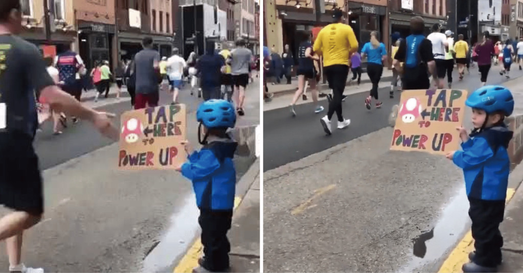 小男孩舉自製加油板子 馬拉松選手一看竟「搶著去碰」:速度變快了!